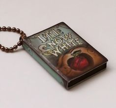 (http://www.foxlilyboutique.com/snow-white-book-charm-necklace/)