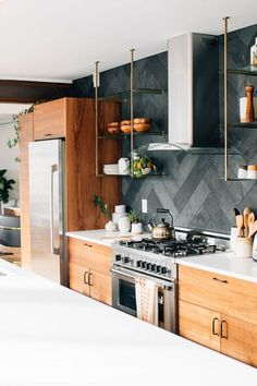 so obsessed with that kitchen! Wood cabinets are back. Love the black herringbone backsplash and open shelving too!  #KitchenRemodel #BacksplasRemodel #Backsplash #Kitchen