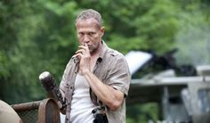 The Governor killed Michael Rooker's Merle by shooting him several times in the chest during the thi... - AMC/Photofest Digital/Promotional