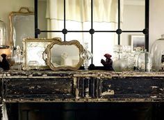 I will always love the elements of crystal/glass/mirrors/light/and old chipped wood contrasted against one another.