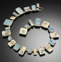 Jeff and Susan Wise.  Miami in Blue.  Aquamarine, White Coral, Reticulated Silver and Gold.