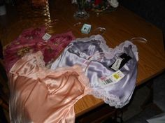 24.00 New amethyst ring sz 6, and 3 new with tags attached blouses size Large 6, Lot of 4 Brand New items
