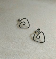 Check out this item in my Etsy shop https://www.etsy.com/it/listing/490141831/triangle-stud-earrings-sterling-silver