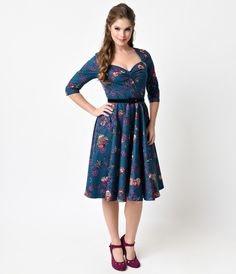 This wildwood wonder is full of whimsy, gals! A fabulously faithful retro inspired dress steeped in picturesque prettiness, The Woodland Floral Dress from Hell Bunny is a teal and purple frock with stunning vintage touches throughout. Featuring three-quar