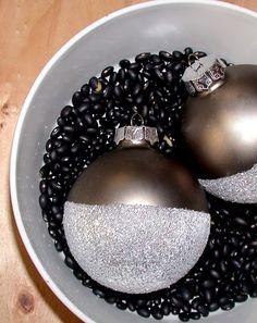 DIY Christmas Ornament  Dip plain ornaments into glue & then glitter.  Easy update to a plain ball.    http://thehuntedinterior.blogspot.com/2011/11/twelve-days-of-christmas-day-3-diy.html