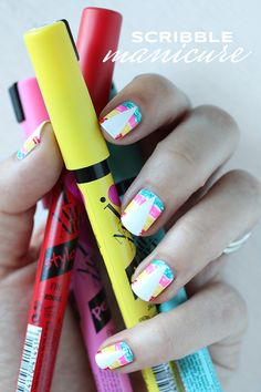 happy #ManiMondays - i thought id do one more bright fun manicure before summer comes to an end! i used tape to get the triangle shapes and then scribbled using @sallyhansen's I Love Nail Art pens.