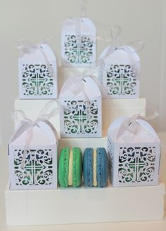 Gorgeous boys baptism party favour (bonbonniere) with two French macarons in blue and green, with passionfruit and white chocolate and vanilla bean).
