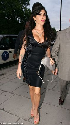 Gorgeous: Amy Winehouse looked stunning in a sexy little black dress which showed off her assets as she attended a Tony Bennett concert in London last night