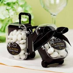 "Mini Rolling Suitcase Favors by Beau-coup, so adorable! ""Whether you're planning a destination wedding, welcoming out-of-town guests or throwing a honeymoon-themed wedding shower, these mini travel favors are just the ticket."""