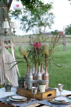 Outdoor party idea. Spray painted bottles for centerpiece