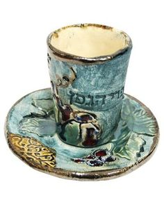 7 Centimeter Handmade Kiddush Cup Set and Plate in Painted Ceramic by World of Judaica. $72.00. Dimensions: 7cm. You will be pleasantly surprised! The vast majority of our shipments arrive within 10-14 business days from time of shipment, far in advance of Amazon's default calculation of shipping times for items shipped from Israel.. Material: Ceramic. Your order includes 1 item(s).. This 7 centimeter handmade Kiddush cup set and plate in painted ceramic features an engraved d...