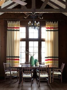 log cabin room decorations:  I love this look.  Notice chandelier and i once had these curtains in wool blankets!