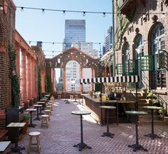 A transporting brick-swathed courtyard with soaring terra cotta columns and fresh-fruit drinks at the Rooftop Lounge at Pod 39.