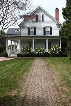 farmhouse. Love the brick walkway and the flowers. ~mdw
