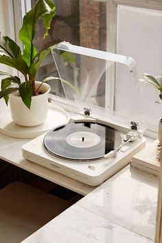 Audio Technica Wireless AT-LP60. I have always loved the idea of a record player, pawing over the record player in my Grand-parents house for years. Love the colour and style.