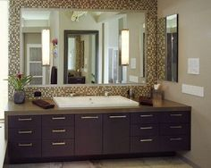 mosaic mirror wall instead of framed mirrors, lights on/through glass