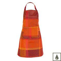 Tablier fêtes et Noël Garnier-Thiebaut - Modèle : Mille wax - Tablier en coton enduit - Coloris : orange et rouge
