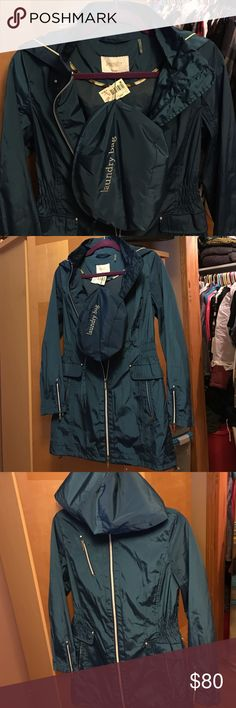 🛍**NEW**Laundry by Shelli Segal mid-length jacket Mid-length jacket size PS color teal. This jacket has zippered pockets and zippers at ends of sleeves to make wider if needed. Has one zipper pocket at top three pockets total. Polyester material comes small bag. *** THIS ITEM IS NEW WITH TAGS NEVER BEEN WORN*** Laundry by Shelli Segal Jackets & Coats