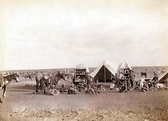 Roundup scenes on Belle Fouche [sic] in 1887. It was made in 1887 by Grabill, John C. H., photographer. The photo illustrates Cowboys seated around chuckwagon at campsite.
