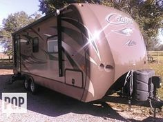 Cougar Lite by Keystone has artic package, queen side bed, sleeps 4 adults, large bathroom, can be towed with 1/2 ton pickup!