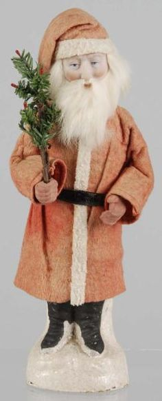 Belsnickel Santa Candy Container.  Description German. All original. Composition face and hands. Detaches at legs to expose candy. Condition...