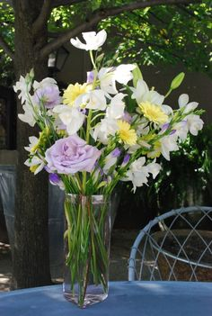 Lisianthus, white dendrobiums, pale yellow gerbera daisies, and lavender freesia