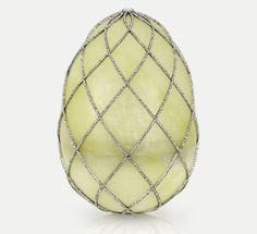 FABERGÉ 1813 WUNTER EGG~ The most expensive made by Fabergé, was invoiced at 24,600 rubles (then £2,460 or £1.87 million in today's money), is made of carved thin rock crystal set with platinum and diamonds, to resemble frost. The surprise inside is a platinum basket of anemones made from white quartz, nephrite, gold and demantoid garnet.