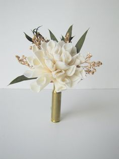Ivory and Gold Bullet Casing Boutonniere - Bullet Shell Boutonniere - Casing Boutonniere - rustic boutonniere - hunting theme wedding - gold by TheBackyardGardener on Etsy https://www.etsy.com/listing/209594322/ivory-and-gold-bullet-casing-boutonniere