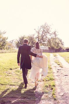 Dorset Wedding Photographs of couple walking away.Photography by one thousand words wedding photographers