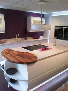 The white Gemini cooker hood looks great in this white and purple kitchen by Lewis and Hobbs.