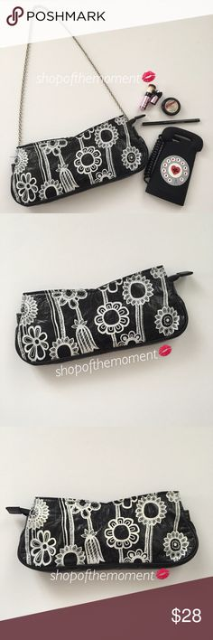 🌻Cheek Boutique Sunflowers Vegan Leather Clutch Cheek Boutique Sunflowers Vegan Leather Clutch  with Chain Handle  🌻🌻🌻🌻🌻🌻🌻🌻🌻🌻🌻🌻  White sunflowers pop off the black background of a vegan leather clutch bag. Long top zip opens wide to let the sweet lining and embroidered nameplate peek out. Cheeky!! Optional silver chain handle with lobster claw clips at both ends.   🌻🌻🌻🌻🌻🌻🌻🌻🌻🌻🌻🌻  ✗ Drama ✗ Trades ⚡️Fast Shipper ☆☆☆☆☆ 5 star seller 💋 Smooches, D Cheek Bags Clutches…
