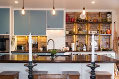 New kitchen in 1950's renovated ex-state house. Walnut bench tops, corian splash back, rimu floors, Edison bulbs.