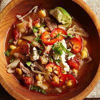 Slow Cooked Beef Pozole - red potatoes - large onion - beef flank steak - beef broth - golden or white hominy - 14.5 oz. can diced tomatoes - fresh poblano chile pepper - hot chili powder - 3 garlic cloves - ground cumin - 3 cups shredded cabbage - crumbled queso fresco - cilantro - lime