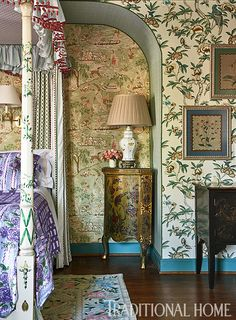 An upholstered alcove and wallpapered walls infuse the bedroom with pattern. - Photo: Dustin Peck / Design: John Loecke and Jason Oliver Nixon