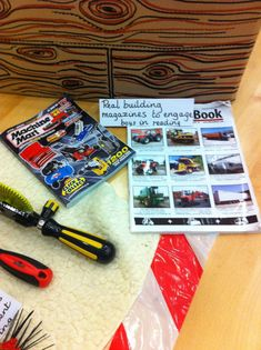 Encourage boys to read by engaging them with magazines about trucks, JCBs, tools etc