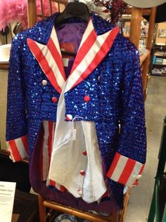 Rubie's Uncle Sam patriotic costume size small. Fabulous sequined costume for a parade, a play, or holiday event--Memorial Day, Independence Day, Labor Day, Presidential election season! From the Regency Collection by Rubies, it includes jacket with tails, shorts, halter top, and shoe covers--5 pieces in all. $75 USD in Booth 702