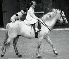 Girl has saddle so dog must ride bareback.