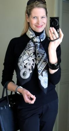 Black jeans and turtleneck sweater accentuated with a Hermes scarf tied with a shawl ring