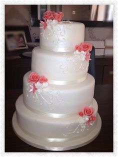 4 tier wedding cake - coral and white