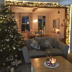 Image may contain: people sitting, living room, table and indoor Kitchen Dining Living, Country Dining Rooms, Real Christmas Tree, Country Interior, Living Spaces, Living Room, Cottage Interiors, Christmas Kitchen, House Extensions