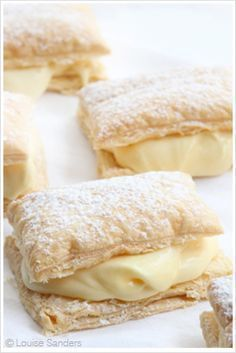 """This recipe isn't called """"Easy Custard Slices"""" for nothing – it makes use instant pudding/custard powder for the filling and pre-made puff pastry so that you get consistent results every time! Even better, you can whip these delicious treats up in less th Custard Recipes, Puff Pastry Recipes, Baking Recipes, Custard Desserts, Custard Powder Recipes, Puff Pastries, Puff Pastry Desserts, Custard Cookies, Italian Pastries"""