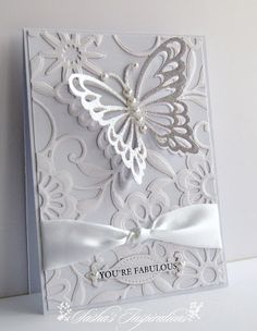 Sasha's Inspirations; whit butterfly on white embossed background with white ribbon