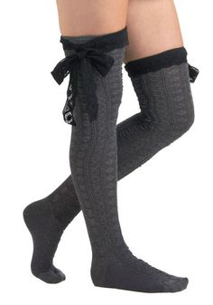 These over-the-knee socks with a crocheted ruffle and oversized bow are the cutest accent to boots with a dress. Betsey Johnson Another Grey-t Day Socks.