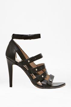 <ul> <li> Leather strappy heels</li> <li> Open toe</li> <li> Straps with push stud fastenings</li> <li> Ankle straps</li> </ul>