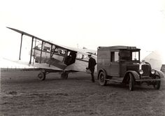 A postman exchanges mail between a light aircraft and Royal Mail van at Wick, Scotland. The aircraft is delivering air mail from the Shetland Island. Date: 1938 Finding number: POST Aeropostale, Celtic Dance, Celtic Nations, Scottish People, Commercial Vehicle, Royal Mail, Old Trucks, Beautiful Landscapes, Britain