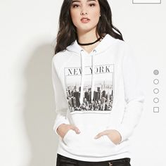 """New York Graphic Hoodie New York Graphic Hoodie This fleece knit hoodie is complete with long raglan sleeves, a kangaroo pocket, and a """"New York"""" graphic on the front with an image of the Manhattan skyline.  Forever 21 Jackets & Coats"""