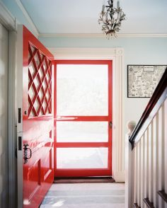 A striped rug in front of a bright red front door | Lonny Jan/Feb 2013
