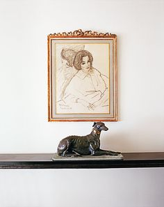 A drawing of Radziwill by René Bouché above a bronze wolfhound in her Paris apartment.