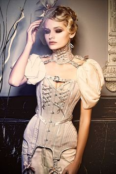 Neo-Victorian Couture Corsetry - For costume tutorials, clothing guide, fashion inspiration photo gallery, calendar of Steampunk events, & more, visit SteampunkFashionGuide.com