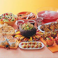 Kids' Halloween Dinner Menu   Witches' Fingers in Bandages  Cauldron Full of Devilish Dip  Spicy Orange Bat Wings  Jack-o'-lantern Quesadillas    Bloody Mary Soup  Bug Salad  Candy-Coated Caramel Apples  Ghoul-Aid Punch